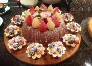 Chocolate Amaretto Pave surrounded by individual fruit & custard pastries