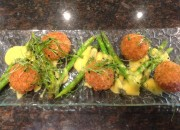 Handmade Quail egg scotch eggs with asparagus and hollandaise sauce
